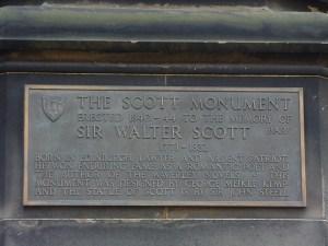 "Text on plaque of Scott Monument, Edinburgh, Scotland: ""Erected 1840-44 to the memory of Sir Walter Scott, 1771-1832"""