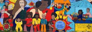 Painted wall mural featuring portraits of People of Color