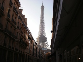 A view of the Eiffel Tower down what could be a French Quarter street.