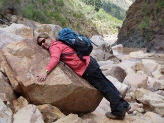 Eva hugging a rock