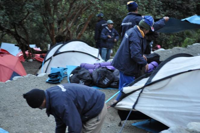 Porters pack up camp at 6am