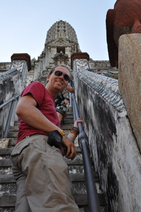 Bill climbing the massive prang at Wat Arun