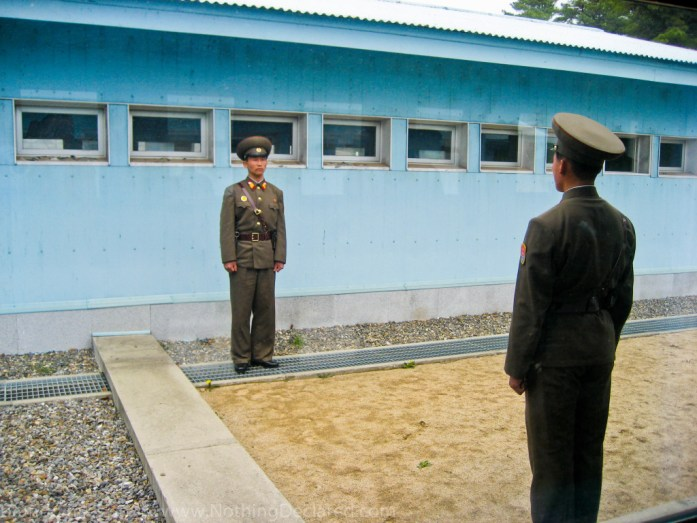 North Korean soldiers guard the Northern side of the Military Demarkation line inside the DMZ's Joint Security Area