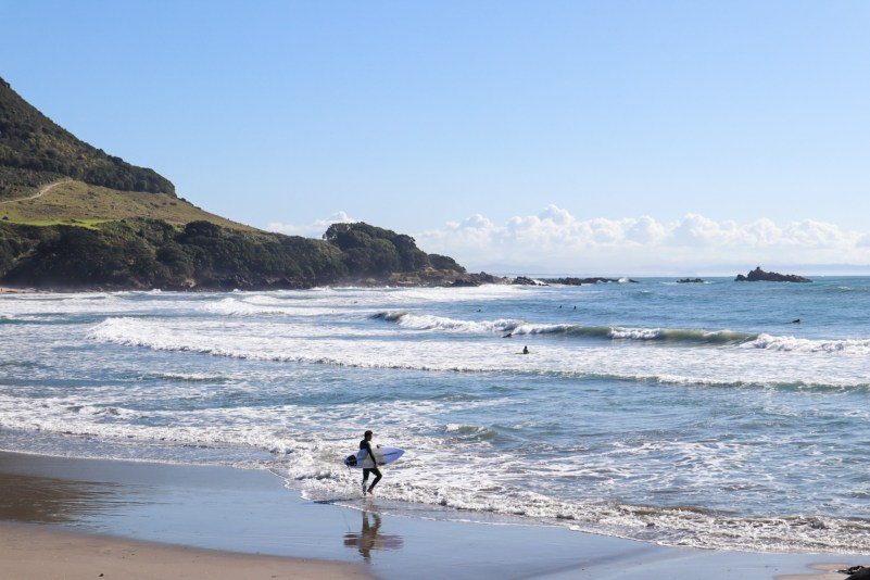 Surfing at Mount Maunganui Beach