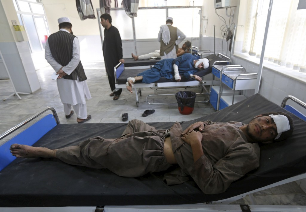Afghan men receive treatment at a hospital after a suicide truck bomb attack in Kabul, Afghanistan