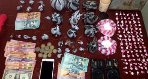 Detienen dos hombres en Guaraguao con presuntas drogas, dinero y otros objetos