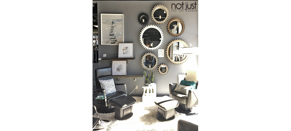 Round Mercana Cog Mirrors on a wall in various sizes and cog shapes in shades of brown in a home decor setting