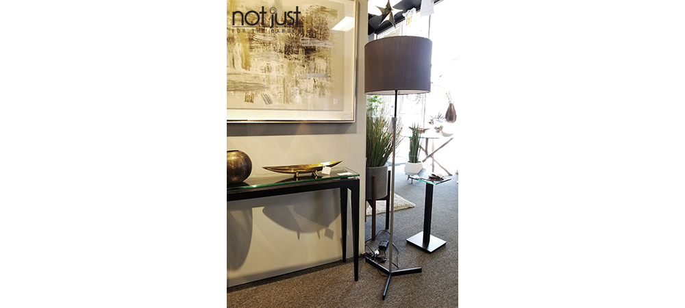 Origina Canada floor lamp with dark grey shade next to framed art and console in home decor setting