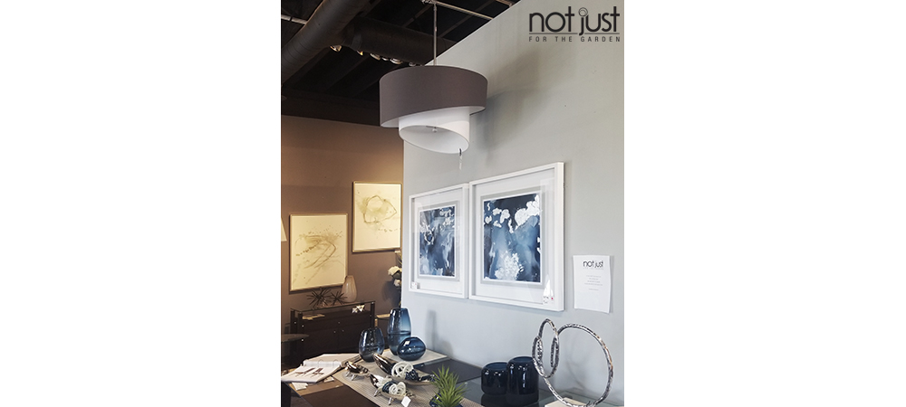 Two tier Canadian made pendant/ceiling light with grey shade and white inner shade, hung over a dining room in a home decor setting