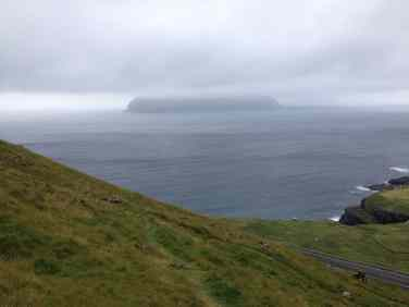 Mykines, on the other hand, the island that can be partially seen enveloped by fog in the picture, might be an objectively remote location on the globe --- it can only be reached by helicopter or boat, and under exceptionally good weather conditions --- the weather in the Faroe Islands changes often, dramatically, and rather unpredictably!