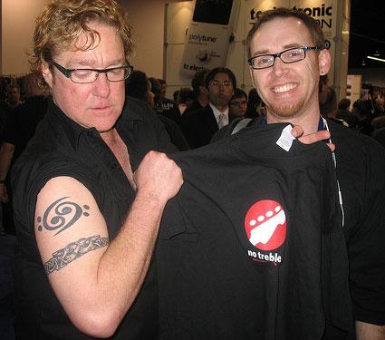 Stu Hamm shows off No Treble tee and tattoo