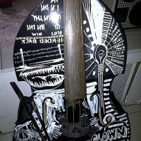 Miles Mosley bass with artwork