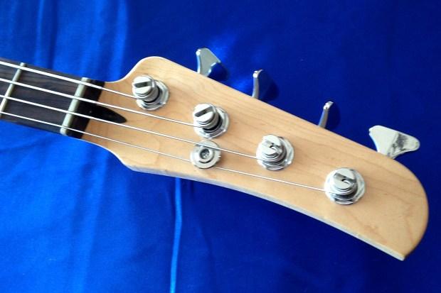 OZZtosh LUMA Aluminum Body Bass - headstock
