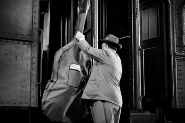 Bassist getting on a train