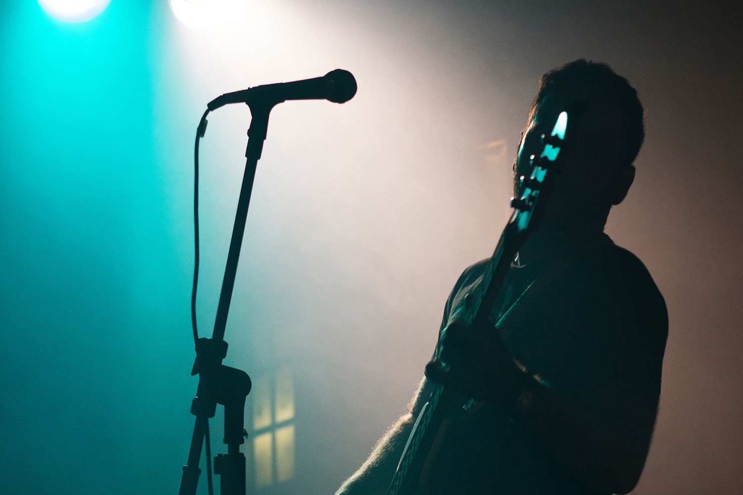 Bassist performing on stage