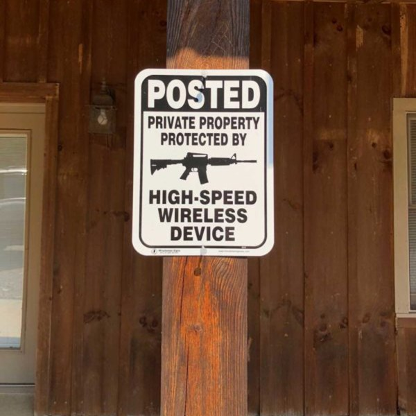 White Aluminum Private Property Protected by Gun on a pole