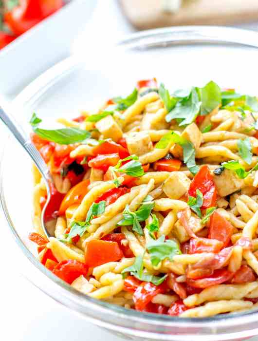 Tomato, mozzarella, and prosciutto pasta - a light, fresh, fast summer meal.