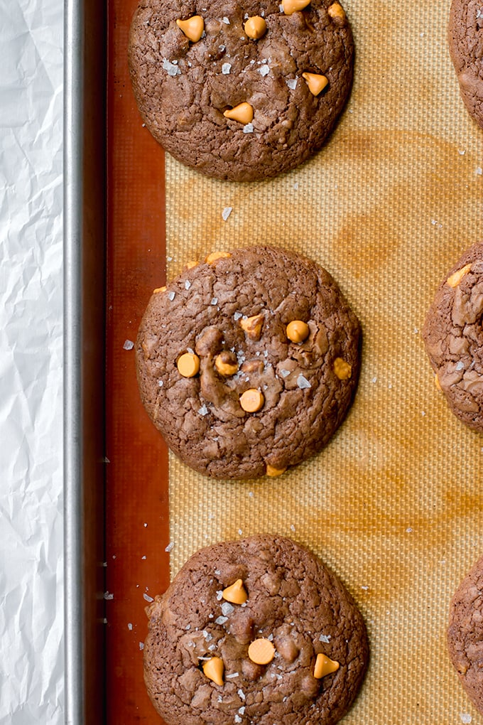 Just-baked toffee butterscotch brownie cookies, cooling on the baking sheet.