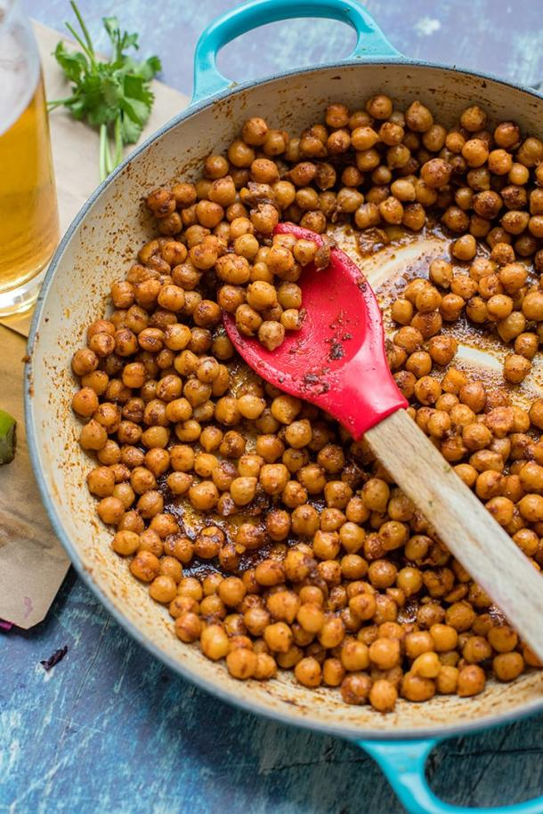 A skillet filled with taco-seasoned crispy chickpeas.