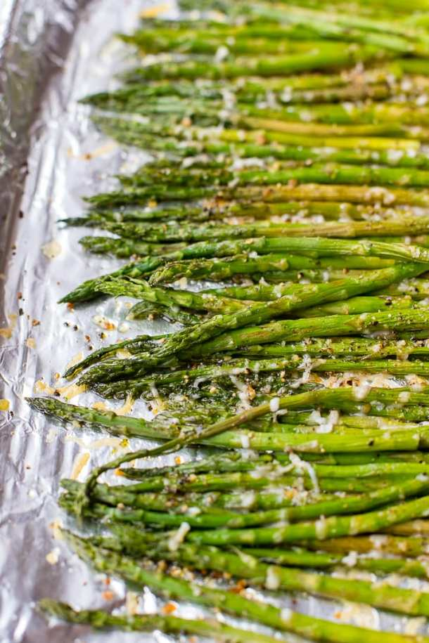 Asparagus drizzled with olive oil and sprinkled with Parmesan, kosher salt, and lemon pepper seasoning.