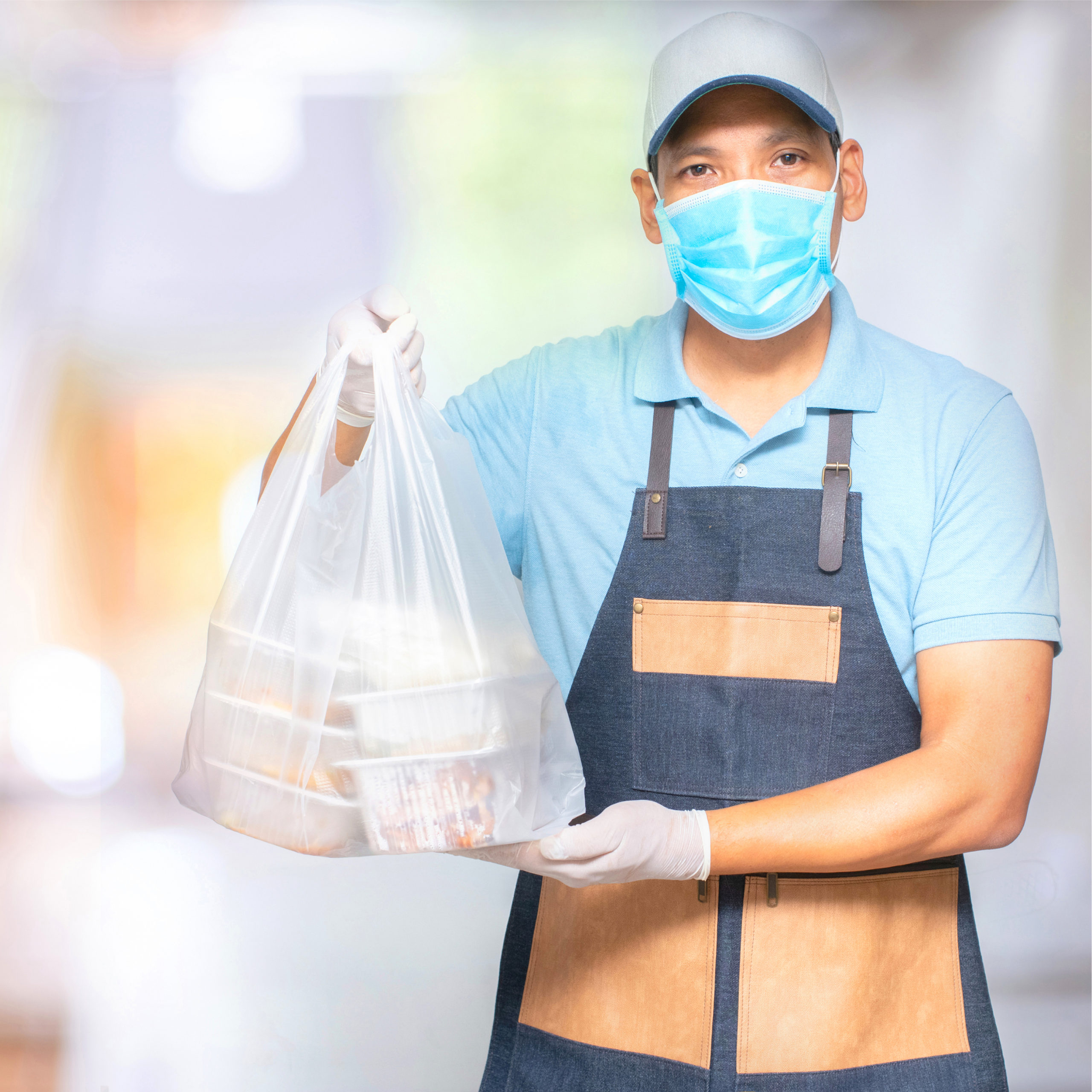 Food delivery person wearing a maske