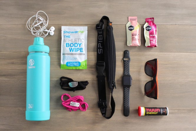 Essential running gear includes Takeya water bottle, shower pill body wipes, momentum jewelry wraps, SPIbelt, my apple watch, energy gels, sunglasses Nuun Energy, and my Apple EarPods