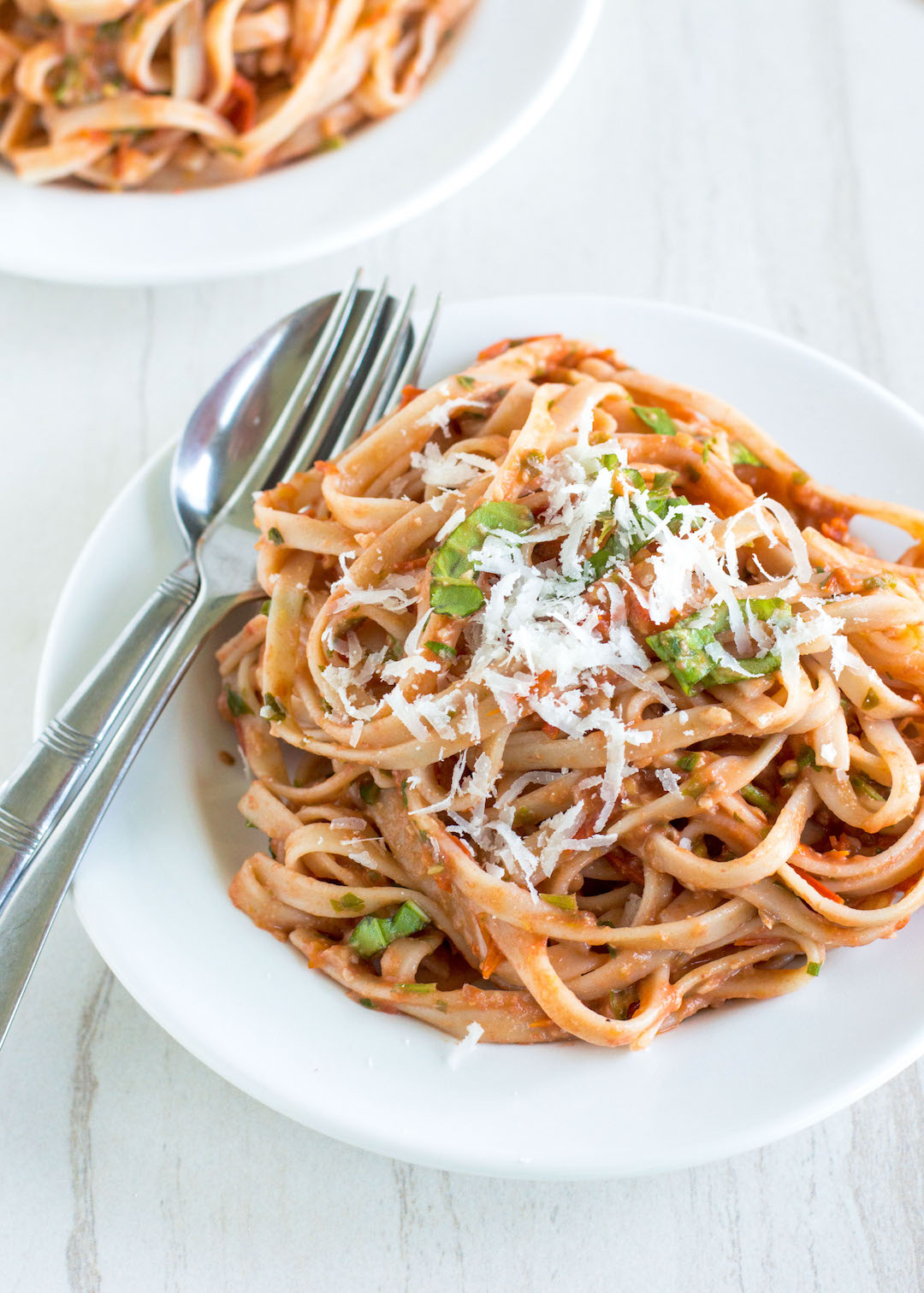 Roasted Tomato and Walnut Pesto Pasta | nourishedtheblog.com | This Roasted Tomato and Walnut Pesto Pasta recipe is a gluten free and vegetarian-friendly pasta dish that everyone will love made with tomatoes, garlic, fresh herbs and walnuts served over your favourite gluten free pasta.