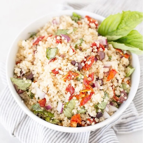 16 Awesome Quinoa Recipe Ideas | nourishedtheblog.com | Sun Dried Tomato Basil Quinoa Salad with Lemon Garlic Vinaigrette from Katie @ Honestly Nourished