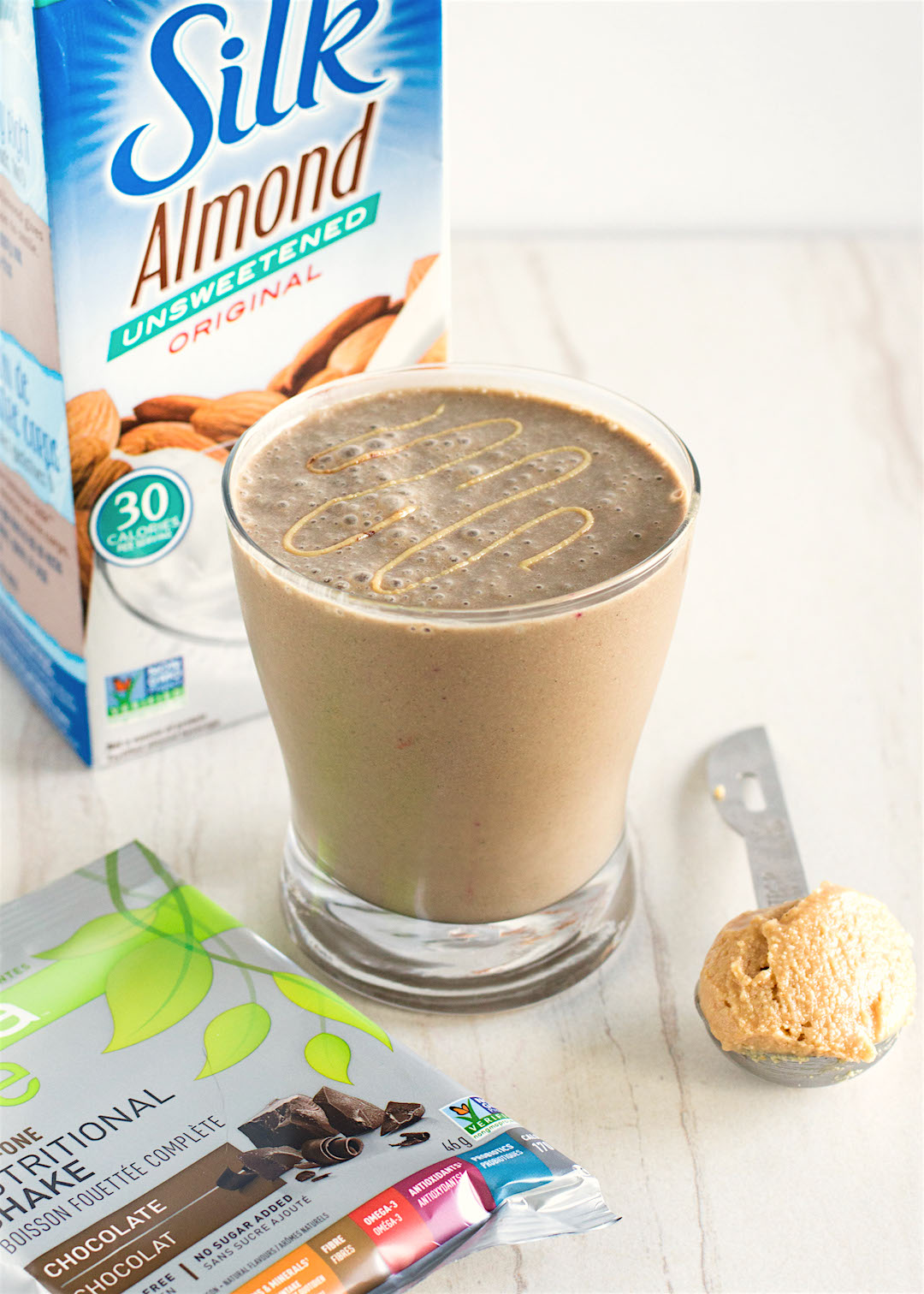 This creamy Chocolate Peanut Butter Protein Smoothie is made gluten free, vegan and protein-packed! It's the perfect combination of all things chocolate, peanut butter and banana! Try it for breakfast OR dessert!