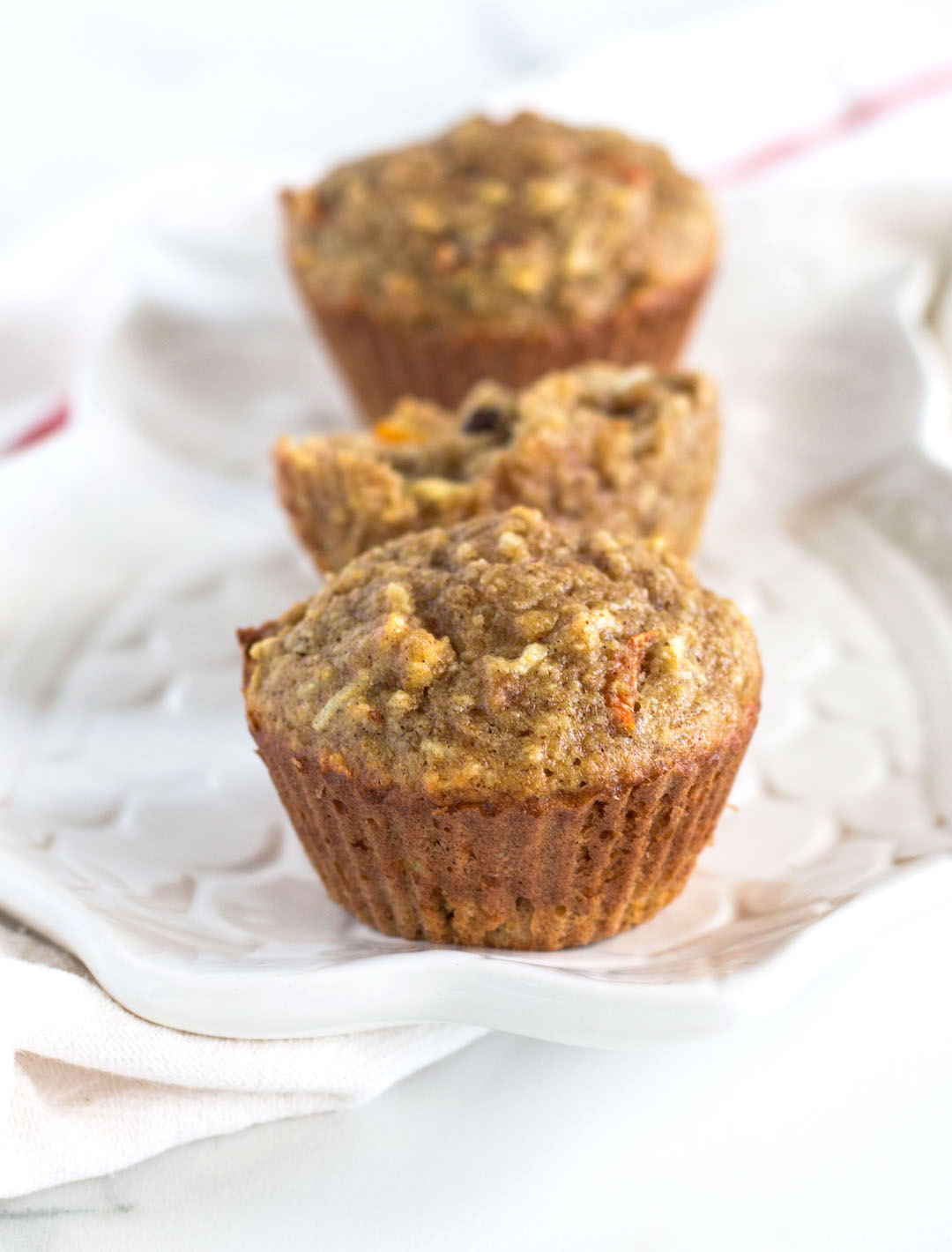These Morning Glory Muffins are jammed pack with everything good making them a great start to your day! Delicious and tender dairy free and Gluten Free Morning Glory Muffins loaded with fresh fruits and vegetables, crunchy walnuts, sweet coconut and chewy dried cranberries. And they make an equally delicious healthy afternoon snack or dessert.