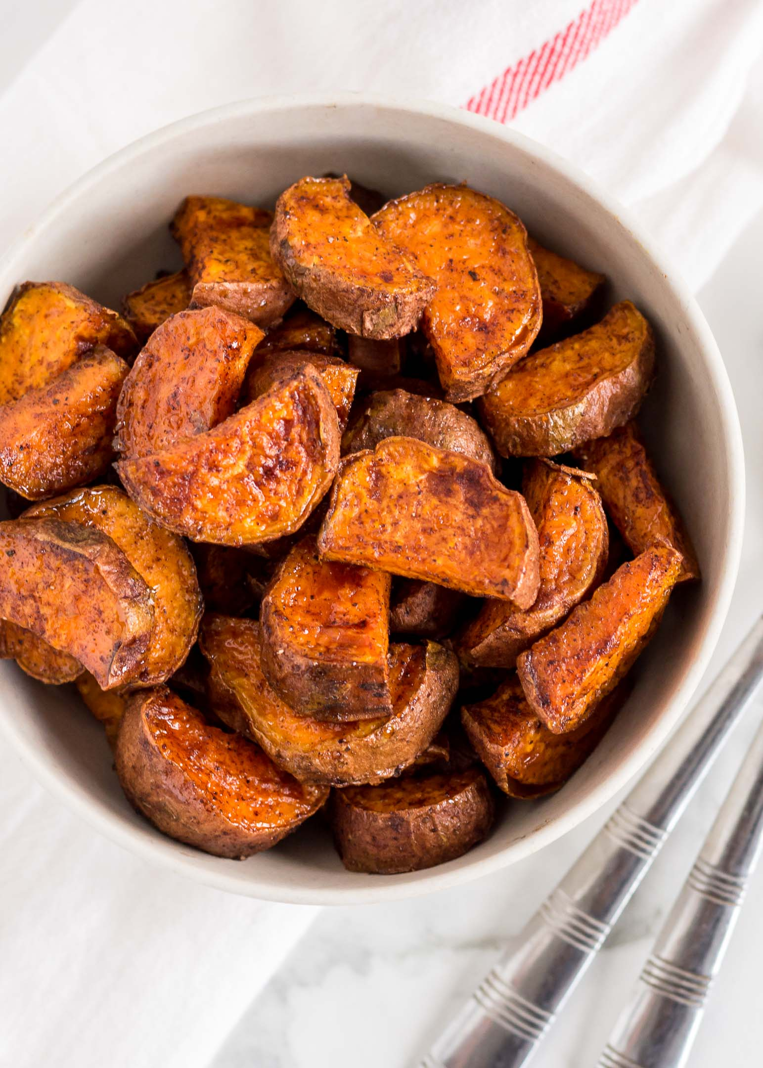 Maple Cinnamon Roasted Sweet Potatoes are simple and healthy side dish to add to any dinner. Here, sweet potatoes are oven-roasted until tender with pure maple syrup and a hint of cinnamon and nutmeg. This easy to make and clean eating recipe is gluten free, dairy free and great for meal prep too.