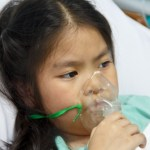Child breathing oxygen