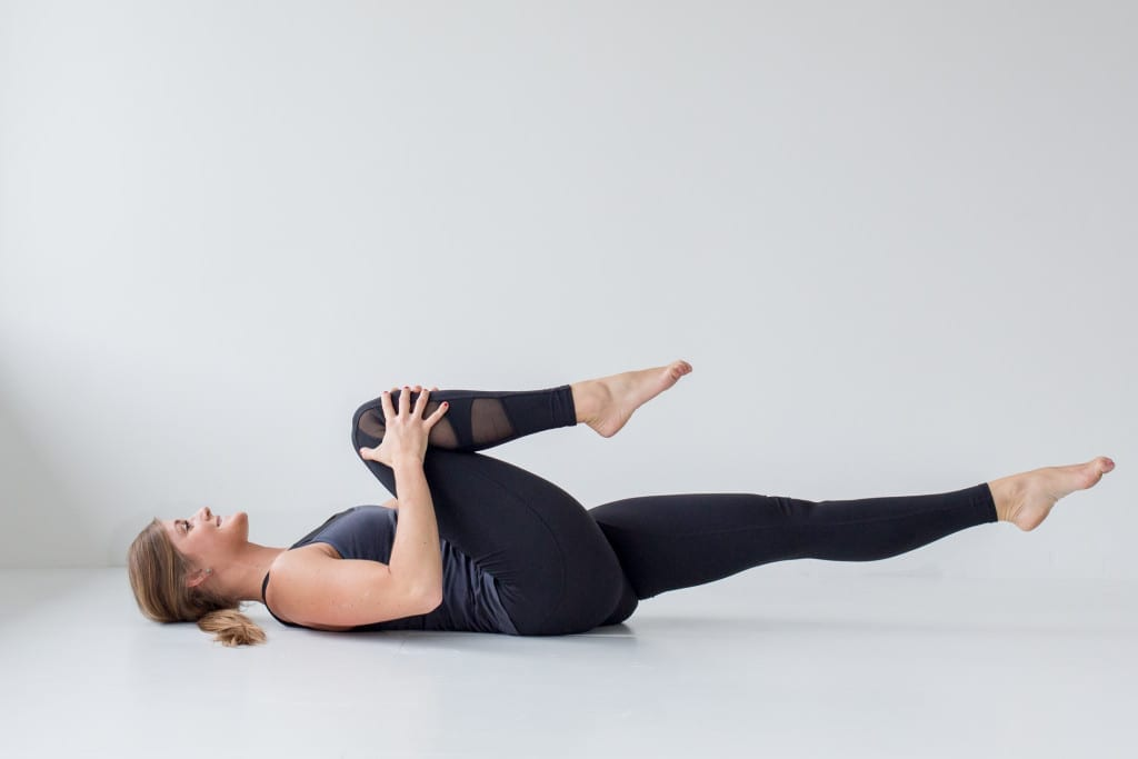10 morning yoga poses, bent leg pull and stretch --- www.nourishmovelove.com