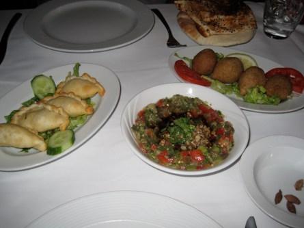 Had dinner at a Lebanese restaurant. Baba Ghanoush in the middle, kubbeh (meat and bulgur dough stuffed with meat and pine nuts) to the right, and cheese burek (cheese stuffed pastries) to the left