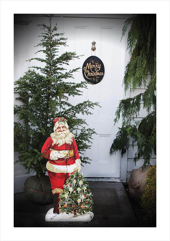Christmas Santa Holding Christmas Tree Decoration