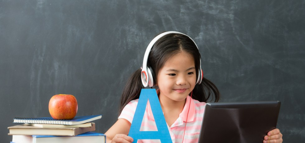 child learning english on tablet
