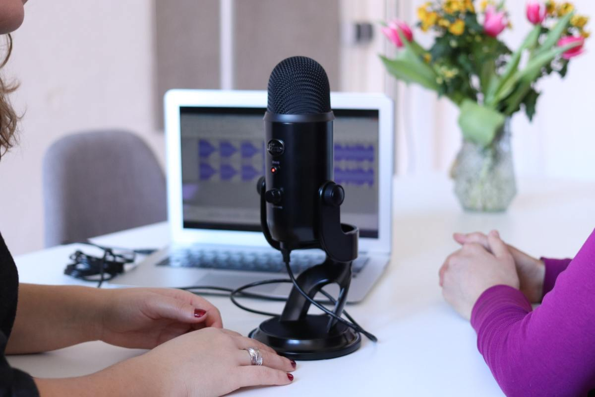Podcast microphone and two women