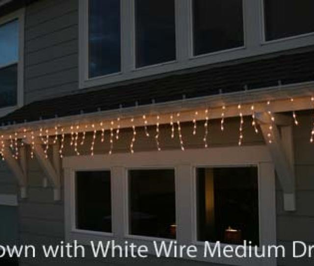 Picture Of Pro Line Icicle Lights Green Wire Long Drops
