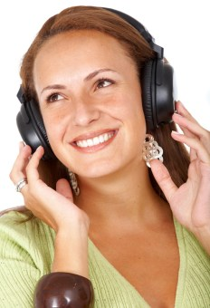 Woman listening to music isolated over a white background