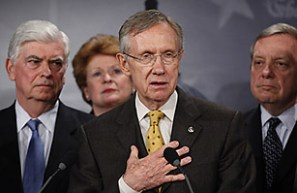 Senate Majority Leader Sen. Harry Reid, D-Nev., second right, with Sens. Chris Dodd, D-Conn., left, Debbie Stabenow, D-Mich., second left, and Dick Durbin, D-Ill., right, speaks to the media about the Democratic health care bill on Capitol Hill, Wednesday, Nov. 18, 2009, in Washington.