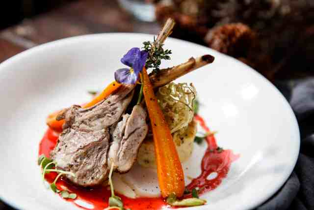 ROASTED RACK OF LAMB, POTATO FLAN WITH GLAZED BABY CARROTS AND MONTEPULCIANO WINE SAUCE