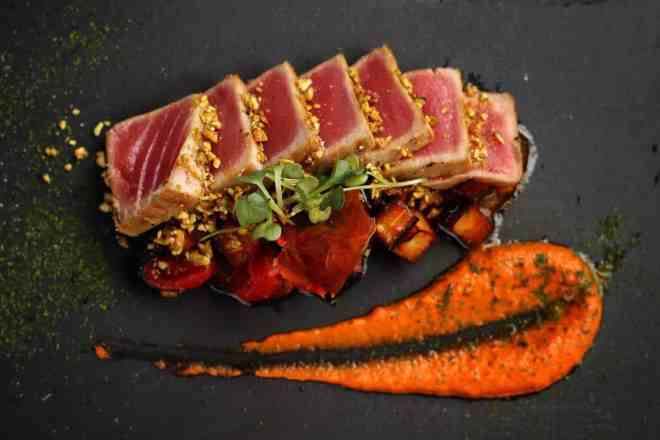 SEARED TUNA IN PISTACHIO CRUST WITH SWEET PEPPERS CREAM AND SICILIAN CAPONATA