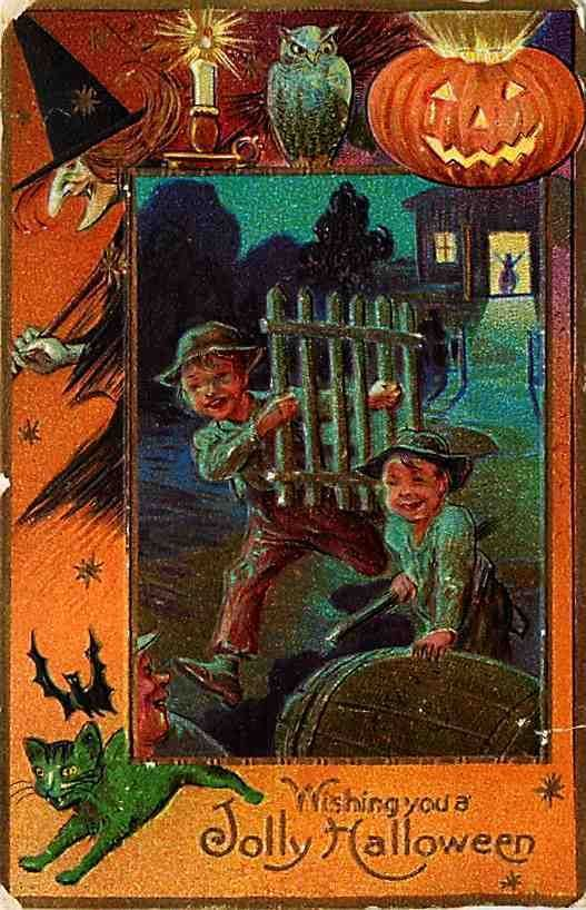 1908 Postcard catches boys stealing a gate as a common Halloween prank.