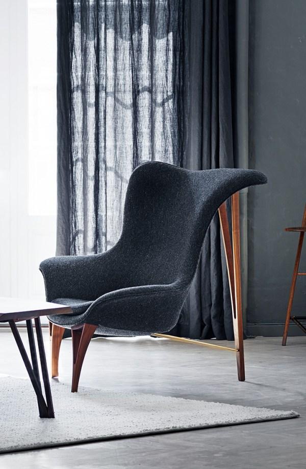 Armchair in wool with walnut legs