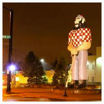 Kenton neighborhood with statue of Paul Bunyan