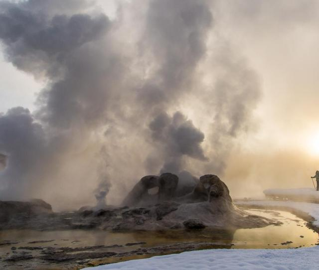 A Skier Enjoys A Winter Sunrise At Grotto Geyser