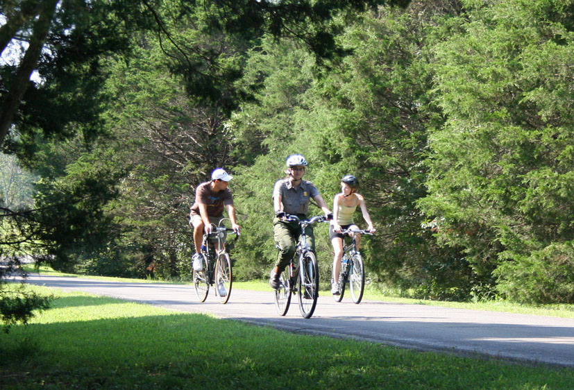Ranger and visitors riding bicycles