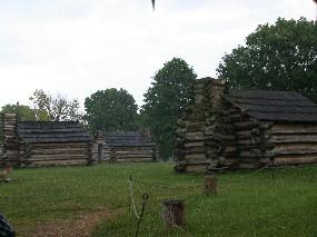 Rain falls onto huts built at the location of Muhlenberg's brigade.