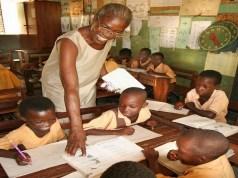 Ghanaian teacher teaches pupils in classroom