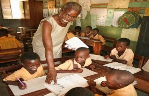 Ghanaian teacher teaches pupils in classroom